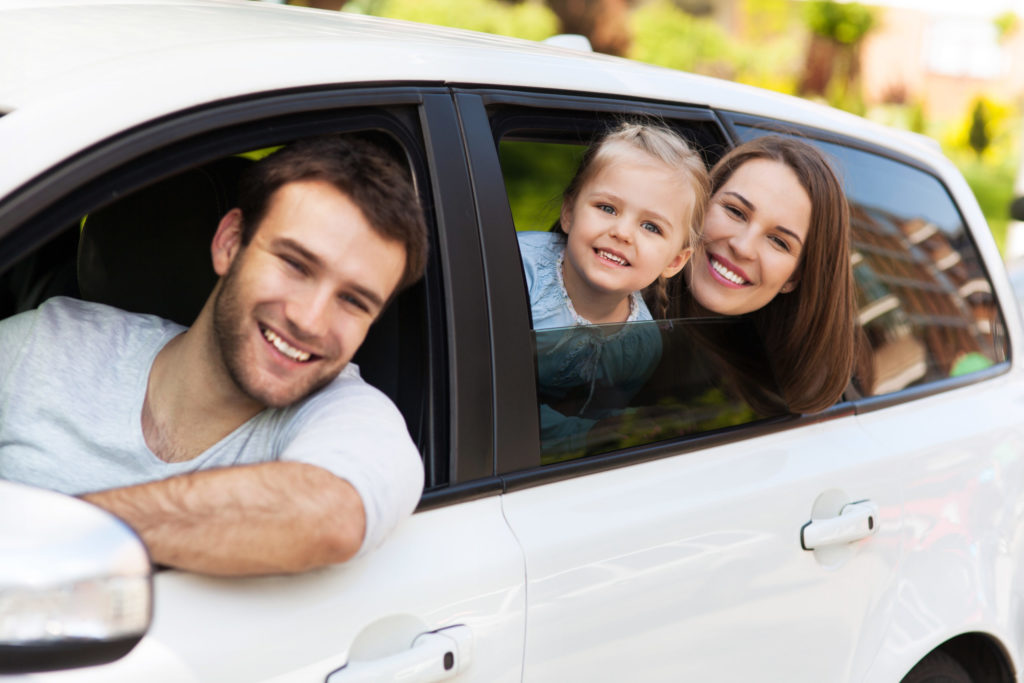 Blog - Family sitting in the car looking out windows